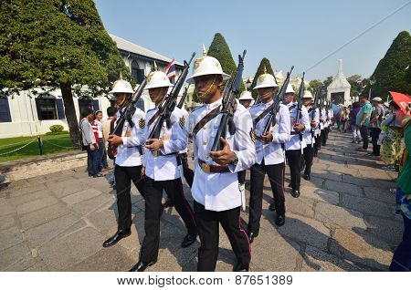 Kings Guards Are Marching In Grand Royal Palace In Bangkok, Thailand