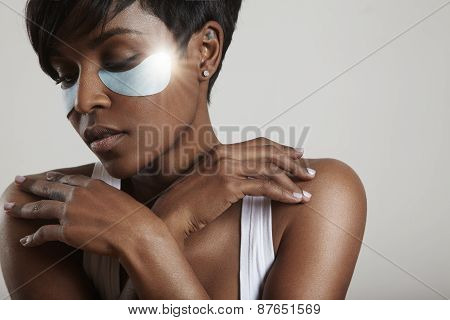 Black Woman Wearing Eye Patches