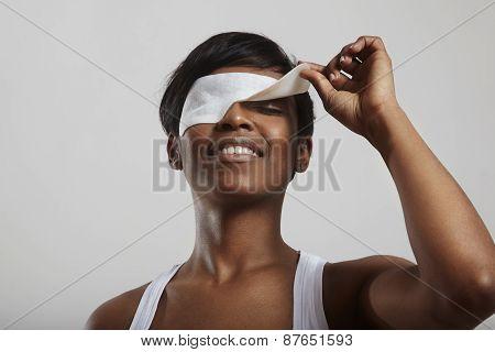 Woman Take Off A Facial Mask