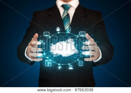 Businessman holding digital icons, Cloud computing concept