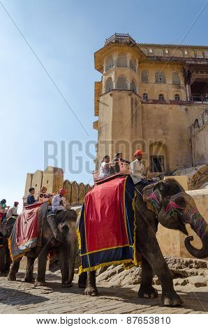 Jaipur, India - December 29, 2014: Tourists Enjoy Elephant Ride In The Amber Fort In Jaipur