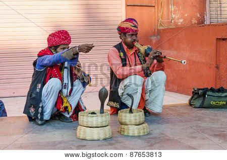 Jaipur, India - December 29, 2014: Snake Charmer Is Playing The Flute For Cobra at Winds Palace