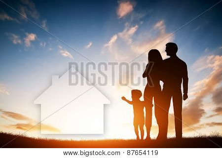 Family dream about a new house, home. Child reaching for a dream with parents. Sunset sun, sky.