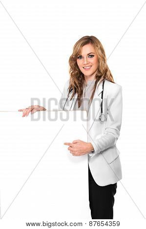 Smiling Female Doctor With Stethoscope And White Blank Board, Isolated