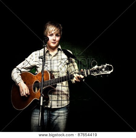 a cute musician playing a solo show with a black background
