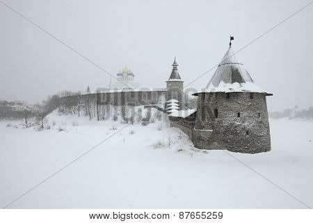 Russian winter. Ploskaya (Flat) Tower and Kutekroma Tower of the Pskov Kremlin (Krom) and the Trinity Cathedral in Pskov, Russia.