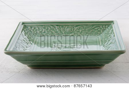 Empty Green Ceramic Plate On Wooden Table