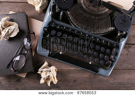 Retro typewriter on wooden table, top view