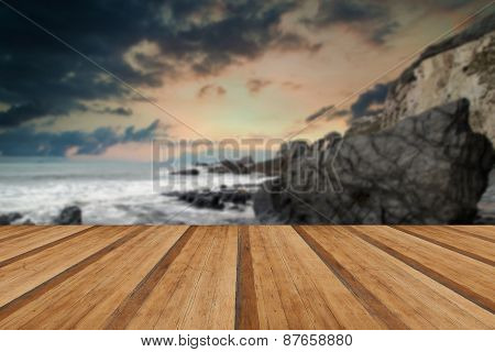 Landscape Seascape Of Jagged And Rugged Rocks On Coastline With Wooden Planks Floor