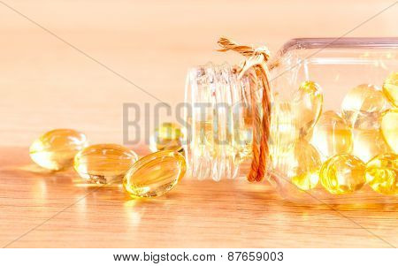 Cod Liver Oil Capsules  On Wooden Panel .