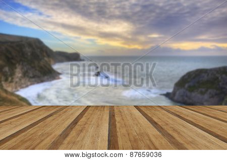 Vibrant Sunrise Over Ocean And Sheltered Cove With Wooden Planks Floor