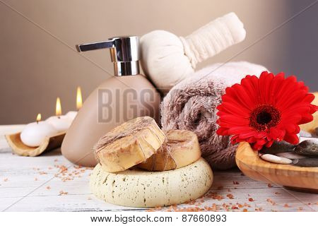 Composition of spa treatment on wooden table, on light color background