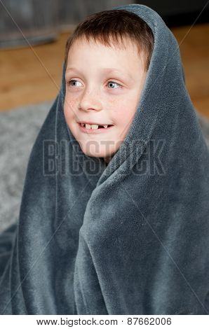 Little boy at home on the carpet
