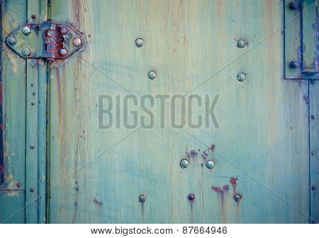 Background with Faded green chipped paint and hinge