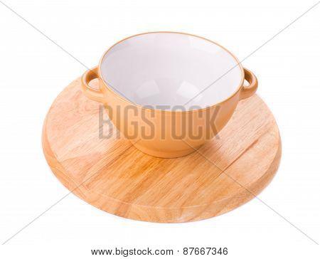 Soup bowl on wood platter.