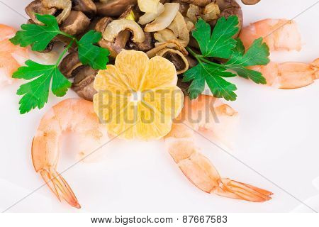 Shrimp salad with mushrooms close up.