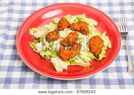 Buffalo Chicken Nuggets On Caesar Salad