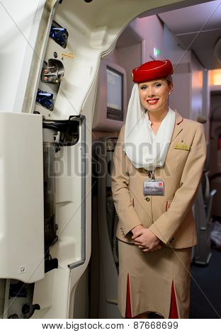 HONGKONG, CHINA - DECEMBER 10, 2014: Emirates Airbus A380 crew member. Emirates handles major part of passenger traffic and aircraft movements at the airport.