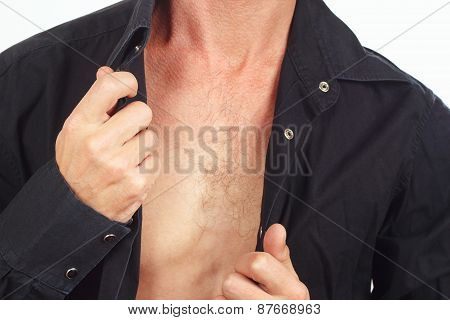 Young man dresses his black shirt closeup
