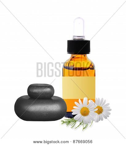Black Spa Stones, Bottle With Essence Oil And Chamomile Flowers Isolated On White
