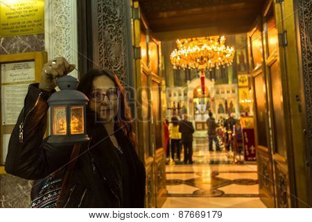 ATHENS, GREECE - APR 12, 2015: Unknown people during celebration of Orthodox Easter (Midnight Office of Pascha) Holy Saturday is often the only time that the Midnight Office will be read in parishes.