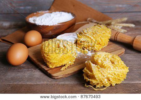 Still life of preparing pasta on rustic wooden background