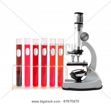 Medical Test Tubes With Blood In Holder And Microscope On White Background