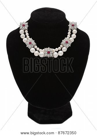 Pendant With Gem Stones On Black Mannequin Isolated On White