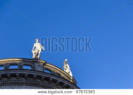 Sandstone Statues At The Roof Of An Old Building At Max Josephs Platz In Munich