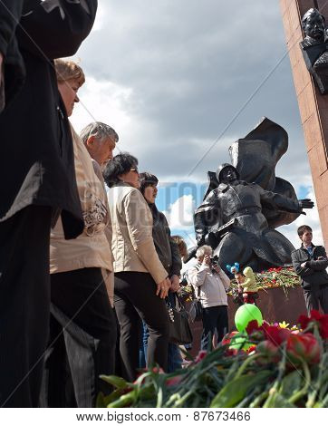UFA,RUSSIA - MAY 9.  Flowers and people near Memorial to the Heroes of the Soviet Union Alexander Ma