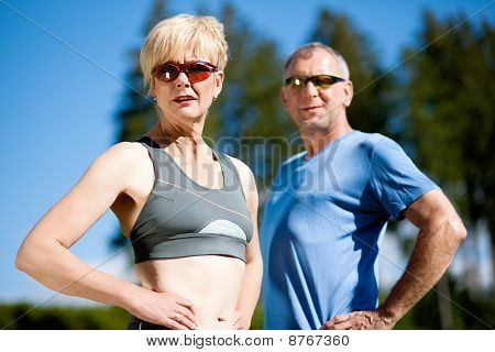 Mature couple doing sport outdoors