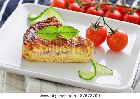 Home Made Ham And Cheese Quiche With Tomatoes And Cucumber