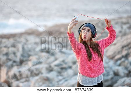 Young girl with smartphone and headphones