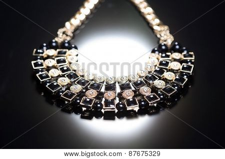 metal feminine necklace. on white background.