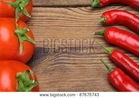 Fresh Peppers And Tomatoes On Wooden Board