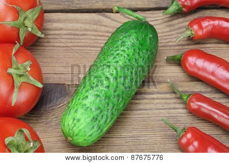 Fresh Tomatoes, Chili Peppers  And  Cucumber On Wooden Board
