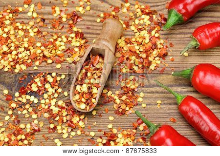 Hot Chili Peppers, Milled  Peppers Flakes On Wooden Board