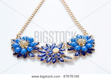 plastic necklace. three blue flower
