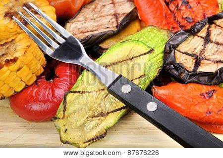 Fork And Grilled Vegetables Assortment On The Wood Table Background