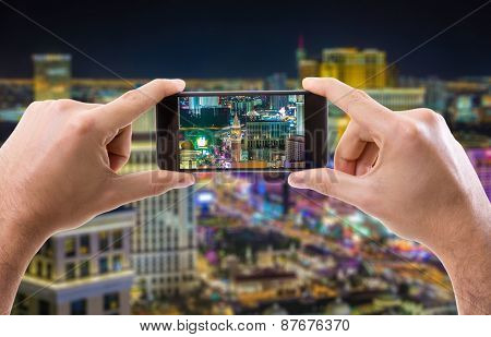 Hand holding Smartphone in Las Vegas, USA
