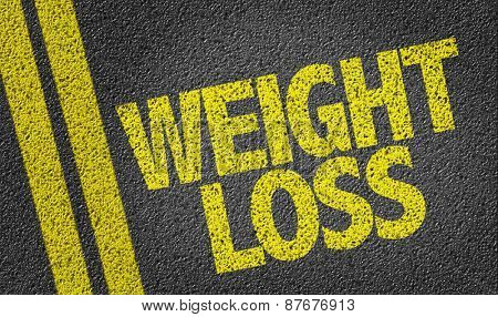 Weight Loss written on the road