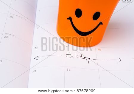 Some Happy Icon On The Calender With Vacation Text