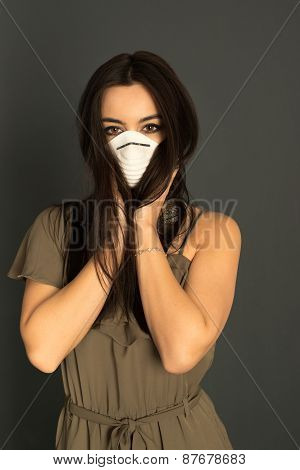 Attractive woman with protective mask