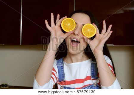 Housewife Holding Orange Slices In Front Of Her Eyes And Plays The Fool
