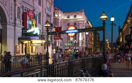 LONDON, UK - AUGUST 22, 2014: Piccadilly Circus in night. Famous place for romantic dates. Square wa