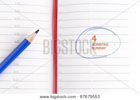 Blue Pencil And Notebook