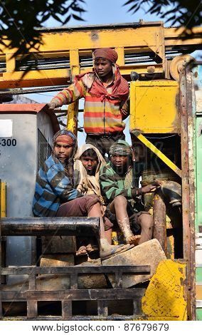 Jaipur, India - December 30, 2014: Unidentified Travellers, Mostly Construction Workers On The Truck