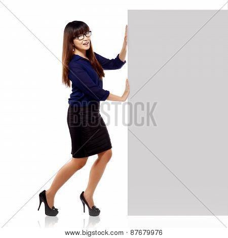 Pretty Asian Brunette Woman Showing An Empty Blankboard