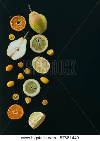 Fresh Fruit Andcitrus Mix On Black: Pieces Of Pear, Mandarin; Gr