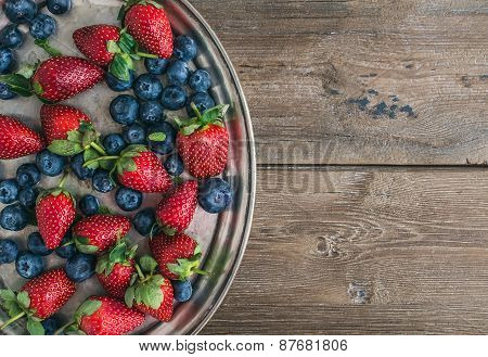 Fresh Strawberry And Blueberry Mix On A Metal Dish (tray) Over A